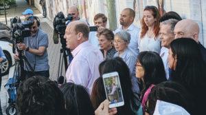 Alderman Harry Osterman speaks at rally opposing ICE raids.